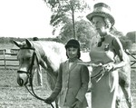 Mrs. Joseph L. Merrill and Young Girl with Horse