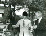 Mr. Ralph Petersen Presents Trophy to Mr. Rodney Mutch